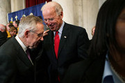 "U.S. Vice President Joseph Biden (R) and Senate Majority Leader Sen. Harry Reid (D-NV) (L) share a moment during a rally October 19, 2011 on Capitol Hill in Washington, DC. Biden joined Senate Democratic leaders to hold a rally with fire fighters, police officers and teachers to call for the passage of S.1723, the ""Teachers and First Responders Back to Work Act."""