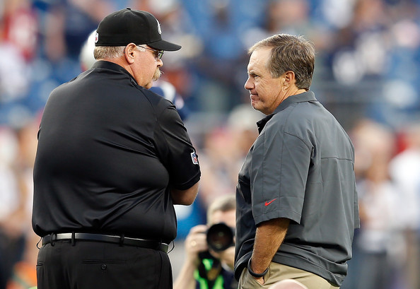 Philadelphia Eagles v New England Patriots [coach,baseball umpire,manager,championship,sport venue,official,gesture,andy reid,bill belichick,foxboro,massachusetts,gillette stadium,philadelphia eagles,new england patriots,preseason game]