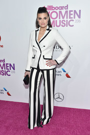 Idina Menzel cut a striking figure in a boldly striped pantsuit at the Billboard Women in Music 2016.