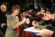 Sandra Bullock signs autographs upon her arrival for the European premiere of the film 'Bird Box' at Zoo Palast on November 27, 2018 in Berlin, Germany.