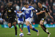 David Bentley of Birmingham City is challenged by Reda Johnson (22) and Liam Palmer (29) of Sheffield Wednesday during the FA Cup Sponsored by e.on 5th Round match between Birmingham City and Sheffield Wednesday at St Andrews on February 19, 2011 in Birmingham, England.