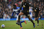 Obafemi Martins of Birmingham City is challenged by Reda Johnson of Sheffield Wednesday during the FA Cup Sponsored by e.on 5th Round match between Birmingham City and Sheffield Wednesday at St Andrews on February 19, 2011 in Birmingham, England.