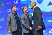 "The founder of Bits & Pretzels Andreas Bruckschloegl and Felix Haas together with U.S. President Barack Obama appear on stage at the opening of the ""Bits & Pretzels Founders Festival"" at ICM Munich on September 29, 2019 in Munich, Germany. The annual event brings together founders and startups from across the globe for three days of networking, talks and inspiration. Bits & Pretzels is an application-only, three-day festival that connects 5,000 founders, investors, startup enthusiasts, taking place from September 29 to October 1, 2019."