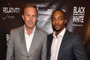 "Kevin Costner and Anthony Mackie attend ""Black or White"" red carpet screening at Regal Atlantic Station on January 22, 2015 in Atlanta, Georgia."