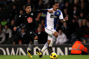 Roque Santa Cruz of Blackburn Rovers competes with Gonzalo Jara of West Bromwich Albion during the Barclays Premier League match between Blackburn Rovers and West Bromwich Albion at Ewood Park on January 23, 2011 in Blackburn, England.