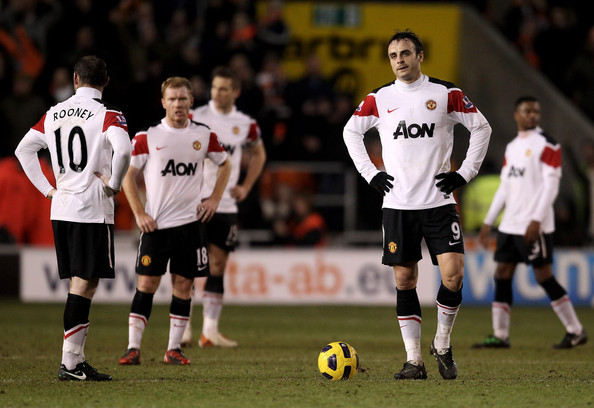 Dimitar Berbatov of Manchester United and his team mates look dejected after conceding a second goal during the Barclays Premier League match between Blackpool and Manchester United at Bloomfield Road on January 25, 2011 in Blackpool, England.