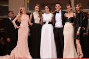 (L-R) Actors Claire Julien, Taissa Farmiga, Katie Chang, Israel Broussard, Emma Watson and director Sophia Coppola attend 'The Bling Ring' premiere during The 66th Annual Cannes Film Festival at the Palais des Festivals on May 16, 2013 in Cannes, France.