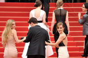 (L-R) Actress Claire Julien, actor Israel Broussard and actress Emma Watson walk behind actresses Taissa Farmiga (C) and Katie Chang (L) during 'The Bling Ring' premiere during The 66th Annual Cannes Film Festival at the Palais des Festivals on May 16, 2013 in Cannes, France.