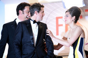 Actors Clive Owen, director Guillaume Canet and actress Marion Cotillard depart the 'Blood Ties' Premiere during the 66th Annual Cannes Film Festival at the Palais des Festivals on May 20, 2013 in Cannes, France.