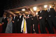 (L-R) Billy Crudup, Zoe Saldana, Guillaume Canet, Clive Owen, Marion Cotillard, James Caan, Lily Taylor, Noah Emmerich, and Domenick Lombardozzi attend the 'Blood Ties' Premiere during the 66th Annual Cannes Film Festival at the Palais des Festivals on May 20, 2013 in Cannes, France.