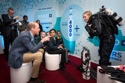 """Prince William, Duke of Cambridge meets Katie Hall, Producer for BBC NHU's Blue Planet II, wearing a rebreather and pupils from the Lionel Road Primary School Primary school, Brentford at the World Premiere of """"Blue Planet II"""" on September 27, 2017 in London, United Kingdom."""