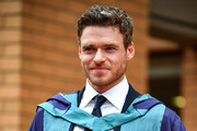 Richard Madden stands on the steps of the Royal Conservatoire of Scotland following receiving an honorary doctorate for his contribution to drama on July 4, 2019 in Glasgow, Scotland. Golden Globe winning actor and star of the Bodyguard television series received his degree at summer graduation ceremony in Glasgow.