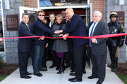 (L-R) North Ward Councilman Anibal Ramos, Jr., musician Jon Bon Jovi, designer Kenneth Cole, HELP USA Chariman Maria Cuomo Cole, City of Newark Mayor Cory Booker, and HELP USA President Laurence Belinsky cut the ribbon at the opening of affordable housing funded through Bon Jovi's JBJ Soul Foundation on December 8, 2009 in Newark, New Jersey.