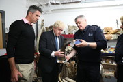 Former England cricketer Kevin Pietersen (L) and British Foreign Secretary Boris Johnson visit the Heathrow 'dead shed' at Custom House in Heathrow, to see seized ivory and rhino horn, and other items relating to the illegal wildlife trade, on May 4, 2018 in Heathrow, England.