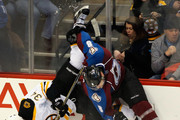 Jan Hejda #8 of the Colorado Avalanche puts a hit on Carl Soderberg #34 of the Boston Bruins and up ends him at Pepsi Center on January 21, 2015 in Denver, Colorado. The Avalanche defeated the Bruins 3-2 in an overtime shootout.