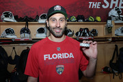 Goaltender Roberto Luongo #1 of the Florida Panthers poses with a puck with the number 1,000 on it after the game against the Boston Bruins at the BB&T Center on April 5, 2018 in Sunrise, Florida. Luongo played in his 1,000 NHL game as a goaltender, joining Martin Brodeur and Patrick Roy in the exclusive club.