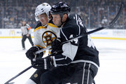 Loui Eriksson #21 of the Boston Bruins and  Regehr #44 of the Los Angeles Kings struggle for position during the first period at Staples Center on December 2, 2014 in Los Angeles, California.