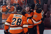 (l-r) Claude Giroux #28, Jakub Voracek #93 and Wayne Simmonds #17 of the Philadelphia Flyers celebrate Simmond's game tying goal at 10:10 of the third period against the Boston Bruins at the Wells Fargo Center on January 13, 2016 in Philadelphia, Pennsylvania. The Flyers defeated the Bruins 3-2.