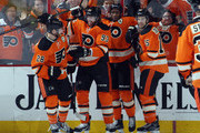 (l-r) Claude Giroux #28, Jakub Voracek #93, Wayne Simmonds #17 and Michael Del Zotto #15 of the Philadelphia Flyers celebrate Simmond's game tying goal at 10:10 of the third period against the Boston Bruins at the Wells Fargo Center on January 13, 2016 in Philadelphia, Pennsylvania. The Flyers defeated the Bruins 3-2.
