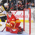 Mike Smith Photos - Patrice Bergeron #37 of the Boston Bruins shoots the puck past the net of Mike Smith #41 of the Calgary Flames during an NHL game at Scotiabank Saddledome on October 17, 2018 in Calgary, Alberta, Canada. - Boston Bruins vs. Calgary Flames