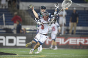 Jordan Burke #5 of the Boston Cannons ties to get around Joe Walters #1 of the Chesapeake Bayhawks during a MLL Lacrosse game at Navy-Marine Corps Memorial Stadium on July 16, 2015 in Annapolis, Maryland.