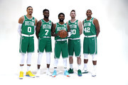 From left Jayson Tatum #0, Jaylen Brown #7, Kyrie Irving #11, Gordon Hayward #20 and Al Horford #42 pose together for a photo during Boston Celtics Media Day on September 24, 2018 in Canton, Massachusetts.