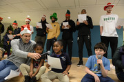 Boston Celtics coach Brad Stevens (L) sings holiday songs with the kids as his team (L to R) Matthew Reynolds, Kenny Graves, Daniel Thiels, Kyrie Irving, Guerschon Yabusele, Al Hereford, and Gordon Hayward back him up  at Boston Children's Hospital December 4, 2018 in Boston, Massachusetts.