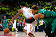 Jared Sullinger #7 of the Boston Celtics fouls out as he grabs ahold of Jeff Teague #0 of the Atlanta Hawks in Game One of the Eastern Conference Quarterfinals during the 2016 NBA Playoffs at Philips Arena on April 16, 2016 in Atlanta, Georgia.  NOTE TO USER User expressly acknowledges and agrees that, by downloading and or using this photograph, user is consenting to the terms and conditions of the Getty Images License Agreement.