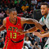 Lamar Patterson Photos - Lamar Patterson #13 of the Atlanta Hawks drives against Evan Turner #11 of the Boston Celtics at Philips Arena on November 24, 2015 in Atlanta, Georgia.  NOTE TO USER User expressly acknowledges and agrees that, by downloading and or using this photograph, user is consenting to the terms and conditions of the Getty Images License Agreement. - Boston Celtics v Atlanta Hawks