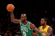 Kevin Garnett #5 of the Boston Celtics controls the ball against Earl Clark #6 of the Los Angeles Lakers at Staples Center on February 20, 2013 in Los Angeles, California.  NOTE TO USER: User expressly acknowledges and agrees that, by downloading and or using this photograph, User is consenting to the terms and conditions of the Getty Images License Agreement.