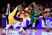 Kyrie Irving #11 of the Boston Celtics dribbles away from Julius Randle #30 and Brandon Ingram #14 of the Los Angeles Lakers during a 108-107 Laker win at Staples Center on January 23, 2018 in Los Angeles, California.