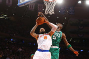 Tyson Chandler #6 of the New York Knicks shoots against Kevin Garnett #5 of the Boston Celtics during Game two of the Eastern Conference Quarterfinals of the 2013 NBA Playoffs at Madison Square Garden on April 23, 2013 in New York City.  NOTE TO USER: User expressly acknowledges and agrees that, by downloading and or using this photograph, User is consenting to the terms and conditions of the Getty Images License Agreement.
