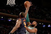 Greg Monroe #55 of the Boston Celtics takes a shot as Kyle O'Quinn #9 of the New York Knicks defends at Madison Square Garden on February 24,2018 in New York City. NOTE TO USER: User expressly acknowledges and agrees that, by downloading and or using this Photograph, user is consenting to the terms and conditions of the Getty Images License Agreement
