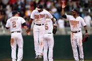 (L-R) Brian Dozier #2, Torii Hunter #48, Eduardo Escobar #5 and Aaron Hicks #32 of the Minnesota Twins celebrate a win over the Boston Red Sox on May 25, 2015 at Target Field in Minneapolis, Minnesota. The Twins defeated the Red Sox 7-2.