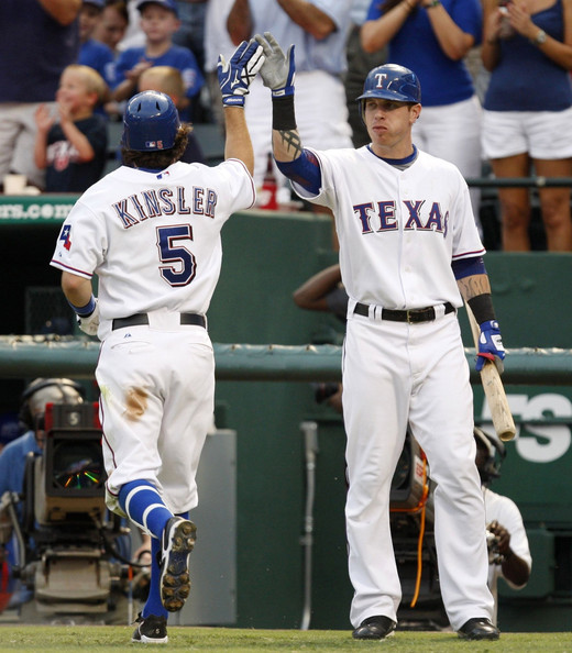 Ian Kinsler Ian Kinsler #5 of the Texas Rangers celebrates his home run with teammate Josh Hamilton #32, tying the game 1-1 during the third inning against the Boston Red Sox at Rangers Ballpark July 22, 2009 in Arlington, Texas.