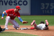 Mookie Betts #50 of the Boston Red Sox steals second base in the second inning during MLB game action as Troy Tulowitzki #2 of the Toronto Blue Jays applies the late tag at Rogers Centre on July 2, 2017 in Toronto, Canada.