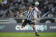 Marcinho (L) of Botafogo struggles for the ball with Henrique of Vasco da Gama during the match between Botafogo and Vasco da Gama as part of Brasileirao Series A 2018 at Engenhao Stadium on October 09, 2018 in Rio de Janeiro, Brazil.