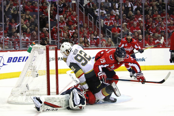 2018 NHL Stanley Cup Final - Game Three [player,college ice hockey,ice hockey,sports gear,ice hockey position,sports,hockey protective equipment,sports equipment,team sport,hockey,tomas nosek,nicklas backstrom,braden holtby 70,game,three,goal,nhl,washington capitals,vegas golden knights,stanley cup final]
