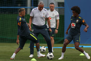 Neymar Jr (L) and Willian in action with the head coach Tite during a training session at Yug-Sport Stadium on June 19, 2018 in Sochi, Russia.