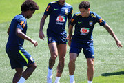 Neymar Jr; Willian and Philippe Coutinho of Brazil take part during a Brazil training session ahead of the FIFA World Cup 2018 at Yug-Sport Stadium on June 12, 2018 in Sochi, Russia.