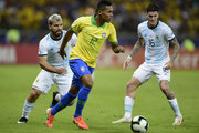 Alex Sandro of Brazil controls the ball against Sergio Aguero of Argentina during the Copa America Brazil 2019 Semi Final match between Brazil and Argentina at Mineirao Stadium on July 02, 2019 in Belo Horizonte, Brazil.