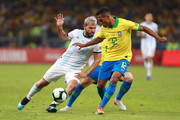 Sergio Aguero of Argentina fights for the ball with Alex Sandro of Brazil during the Copa America Brazil 2019 Semi Final match between Brazil and Argentina at Mineirao Stadium on July 02, 2019 in Belo Horizonte, Brazil.