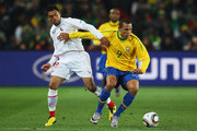 Gonzalo Jara of Chile attempts to tackle Luis Fabiano of Brazil during the 2010 FIFA World Cup South Africa Round of Sixteen match between Brazil and Chile at Ellis Park Stadium on June 28, 2010 in Johannesburg, South Africa.