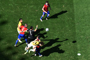 Claudio Bravo of Chile knocks the ball clear against Fred and David Luiz of Brazil as Francisco Silva and Gonzalo Jara defend during the 2014 FIFA World Cup Brazil round of 16 match between Brazil and Chile at Estadio Mineirao on June 28, 2014 in Belo Horizonte, Brazil.