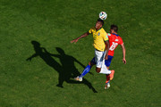 Jo of Brazil and Gonzalo Jara of Chile go up for a header during the 2014 FIFA World Cup Brazil round of 16 match between Brazil and Chile at Estadio Mineirao on June 28, 2014 in Belo Horizonte, Brazil.