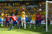 David Luiz of Brazil scores his team's first goal past goalkeeper Claudio Bravo of Chile during the 2014 FIFA World Cup Brazil round of 16 match between Brazil and Chile at Estadio Mineirao on June 28, 2014 in Belo Horizonte, Brazil.