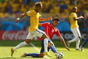 Gonzalo Jara of Chile challenges Neymar of Brazil during the 2014 FIFA World Cup Brazil round of 16 match between Brazil and Chile at Estadio Mineirao on June 28, 2014 in Belo Horizonte, Brazil.