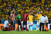 Marcelo of Brazil signals to the bench as teammate Neymar receives treatment after a challenge during the 2014 FIFA World Cup Brazil Quarter Final match between Brazil and Colombia at Castelao on July 4, 2014 in Fortaleza, Brazil.