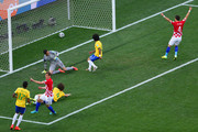 Nikica Jelavic and Ivan Perisic of Croatia celebrate as Julio Cesar, David Luiz and Marcelo of Brazil watch a deflected shot cross the goal line during the 2014 FIFA World Cup Brazil Group A match between Brazil and Croatia at Arena de Sao Paulo on June 12, 2014 in Sao Paulo, Brazil.