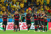 Sami Khedira of Germany (C) celebrates with his team-mates (L-R)  Mesut Oezil, Miroslav Klose, Benedikt Hoewedes, Bastian Schweinsteiger, Thomas Mueller, Toni Kroos of Germany and Philipp Lahm after scoring their fifth goal during the 2014 FIFA World Cup Brazil Semi Final match between Brazil and Germany at Estadio Mineirao on July 8, 2014 in Belo Horizonte, Brazil.